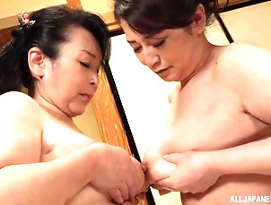 Mature,Japanese Lesbian pussy licking on the bed is a...