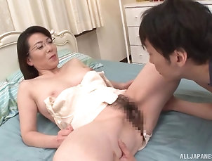 Couple,Hardcore,Asian,Japanese,Natural Tits,Glasses Asian milf treats him to the finest...